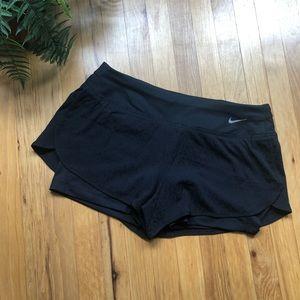Nike • Black animal print running shorts